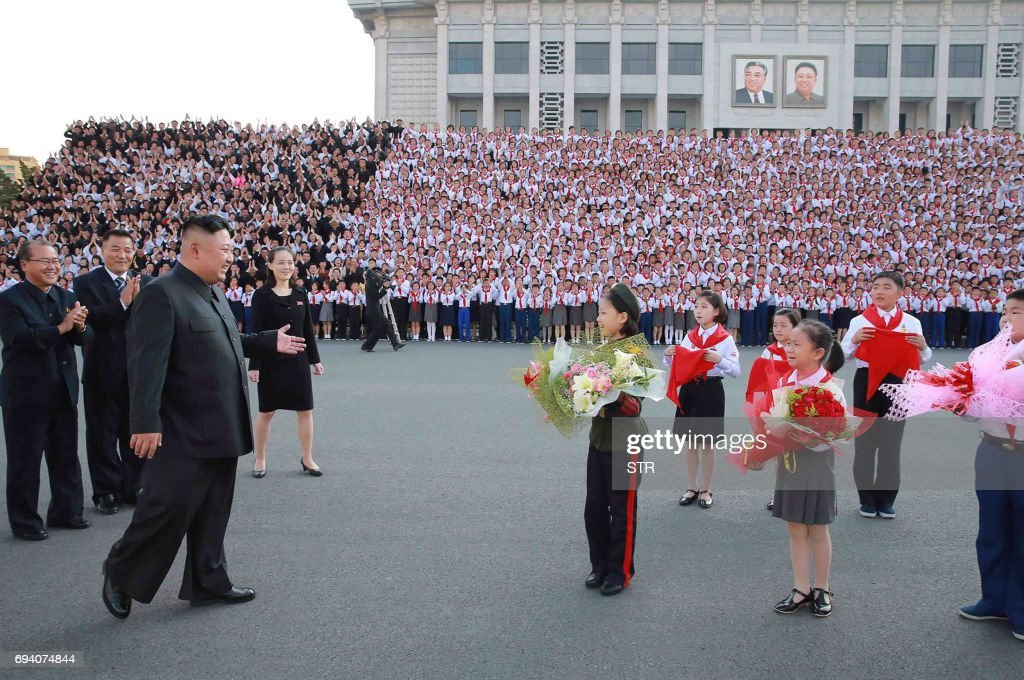 This picture taken on June 6, 2017 and released from North Korea's official Korean Central News Agency (KCNA) on June 9 shows North Korean leader Kim Jong-Un (front L) at a photo session with the participants in the 8th Congress of the Korean Children's Union (KCU) in Pyongyang. /