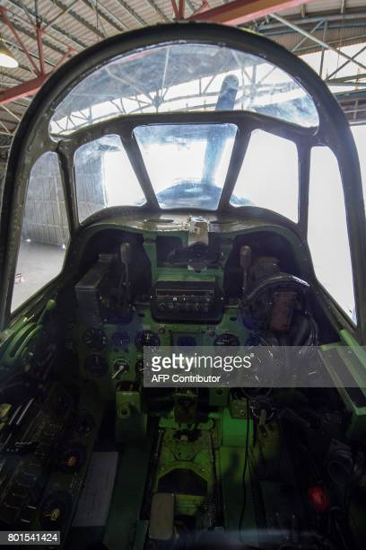 This picture taken on June 6 2017 shows the cockpit of a restored World War IIera Mitsubishi A6M Type 22 Zero fighter at an airfield in Ryugasaki...