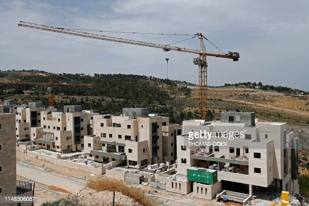 This picture taken on June 6, 2019 shows buildings under construction in Gilo, a Jewish settlement in the mainly Palestinian eastern sector of...