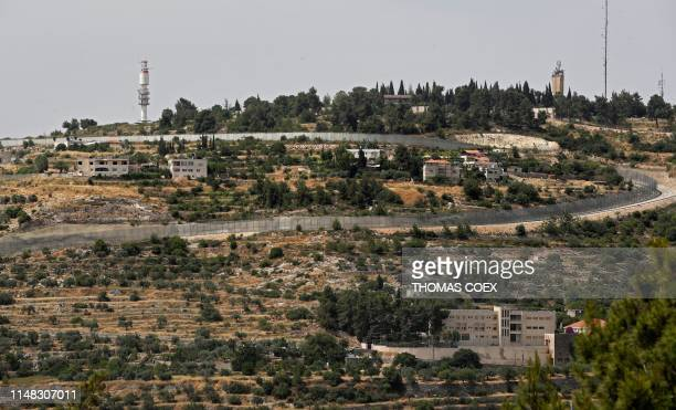This picture taken on June 6 2019 shows Israel's controversial separation barrier separating the West Bank city of Beit Jala near Bethlehem and...
