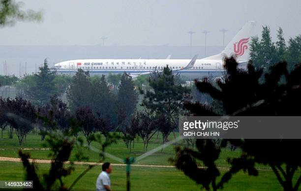 This picture taken on June 7 shows an Air China plane taxiing for take-off at the Beijing Capital International airport in Beijing. The debt crisis...