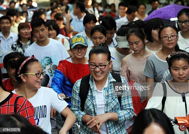This picture taken on June 8 2015 shows high school students walking out of a school after sitting the 2015 national college entrance examination or...