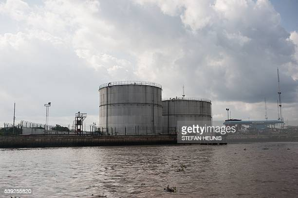 This picture taken on June 8 2016 shows a fuel storage facility in Warri Delta State on June 8 2016 The oil rich Delta region in Nigeria has seen the...