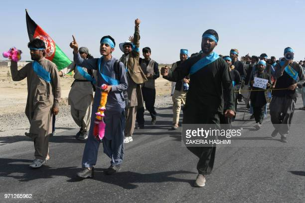 This picture taken on June 8, 2018 shows Afghan peace activists shouting slogans in demand to an end to the war as they start their march from...