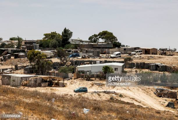 This picture taken on June 8, 2021 shows a view of houses in the unrecognised bedouin village of Sawaneen in Israel's southern Negev Desert. - The...