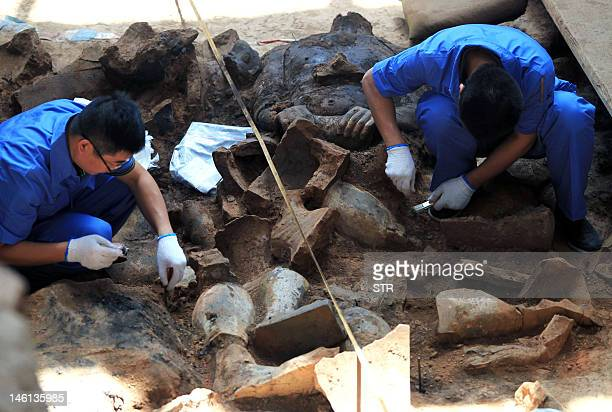 This picture taken on June 9 2012 shows Chinese archaeologists at work in the extended excavation of the Pit One of the Terracotta Warriors and...