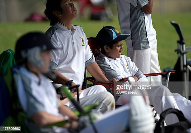 This picture taken on June 9 2013 shows children from diffiferent origins including Australia wait inside a dressing room during a cricket match in...
