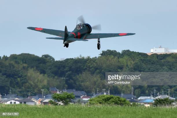 This picture taken on June 9 2017 shows a restored World War IIera Mitsubishi A6M Type 22 Zero fighter taking off from an airfield in Ryugasaki...