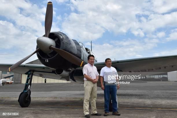 This picture taken on June 9 2017 shows Japanese entrepreneur Masahide Ishizuka owner of a restored World War IIera Mitsubishi A6M Type 22 Zero...