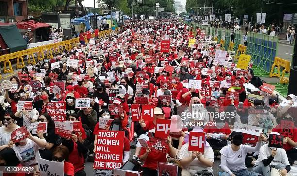 This picture taken on June 9 2018 shows South Korean women staging a monthly protest against secretlyfilmed spycam pornography in Seoul Since May the...