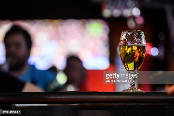 This picture taken on June 9 shows a glass of beer at a bar in the popular entertainment district Wanchai in Hong Kong. - A spiked drink, a puff of...