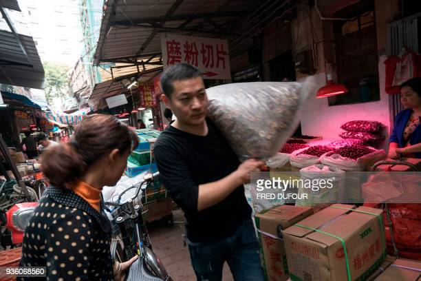 This picture taken on March 1 2018 shows a market popular for selling ingredients for traditional Chinese medicine in Guangzhou in southern China's...