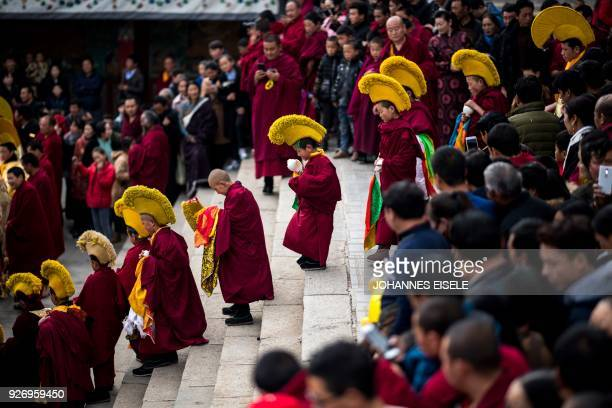 TOPSHOT This picture taken on March 1 2018 shows Tibetan Buddhist monks praying during a ceremony for Monlam otherwise known as the Great Prayer...