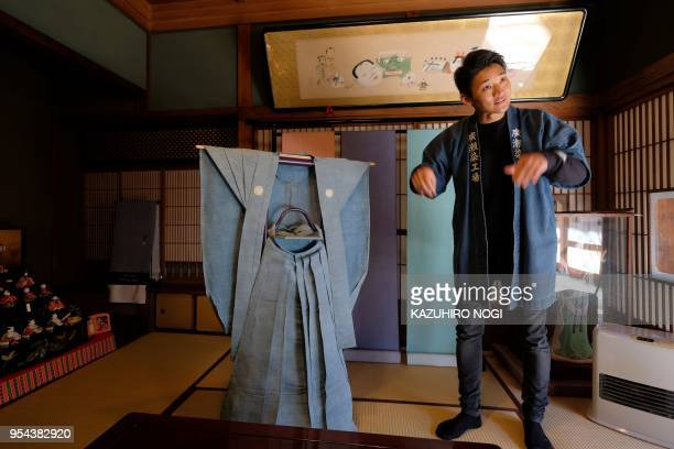 TOPSHOT This picture taken on March 1 2018 shows Yuichi Hirose a craftsman who dyes white fabrics with meticulously handcut stencils for a kimono...