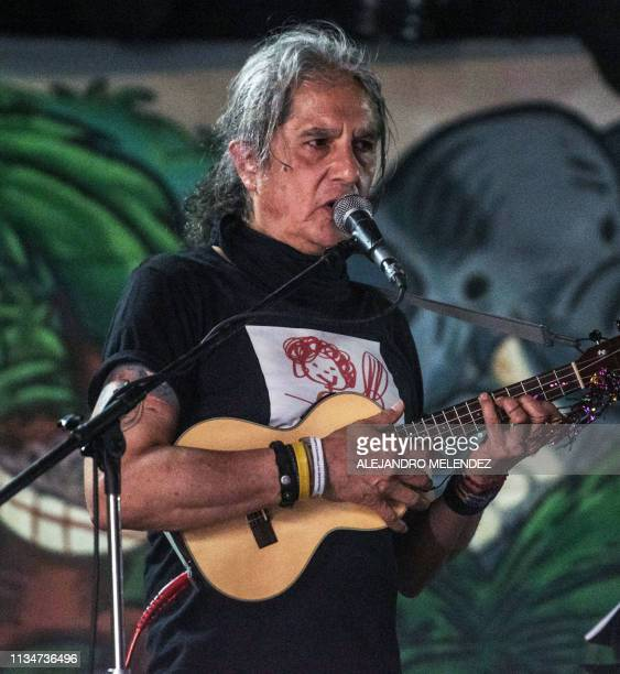 This picture taken on March 11 2018 shows vocalist and founder of Mexican veteran rock band Botellita de Jerez Armando Vega Gil during a concert in...