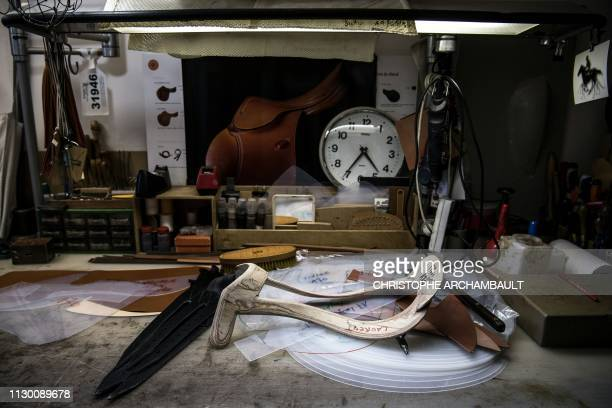 This picture taken on March 11 2019 shows a desk at the French luxury brand Hermes' saddlery in Paris Since 1880 Hermes has been making sports and...