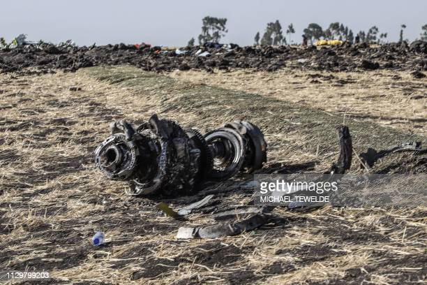 TOPSHOT This picture taken on March 11 shows debris of the crashed airplane of Ethiopia Airlines near Bishoftu a town some 60 kilometres southeast of...