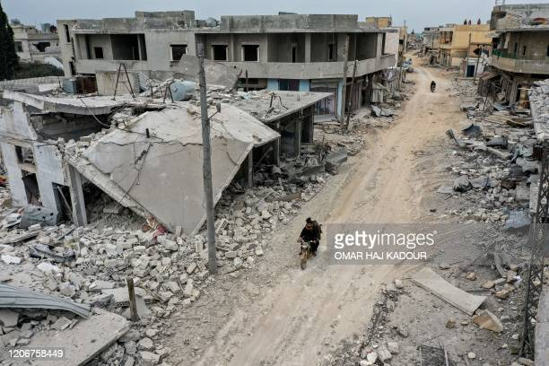 This picture taken on March 12 2020 shows an aerial view of the town of Afis which has sustained widespread destruction due to heavy fighting and...