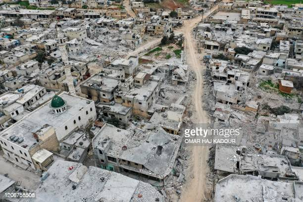 This picture taken on March 12, 2020 shows an aerial view of the town of Afis, which has sustained widespread destruction due to heavy fighting and...