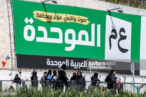 This picture taken on March 12, 2021 shows a view of an electoral billboard by veteran politician Mansour Abbas' United Arab List, bearing their...
