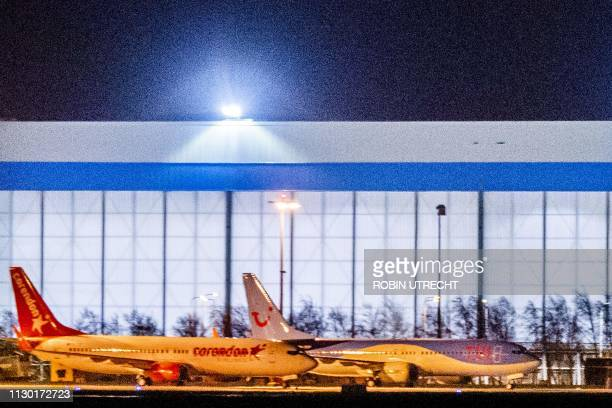 This picture taken on March 12 shows a TUI Airways Boeing 737 MAX 8 aircraft on the tarmac at Schiphol Airport the Netherlands Despite the aviation...