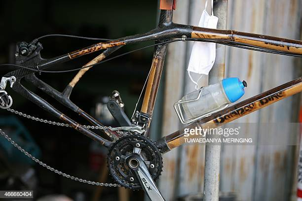 This picture taken on March 13 2015 shows an assembled bamboomade bicycle frame complete with the drive at Thai craftsman Sanit Tuanjolong's workshop...