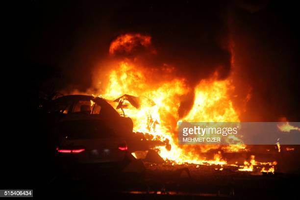 TOPSHOT This picture taken on March 13 shows a burning car after a blast in Ankara An explosion ripped through a busy square in central Ankara on...