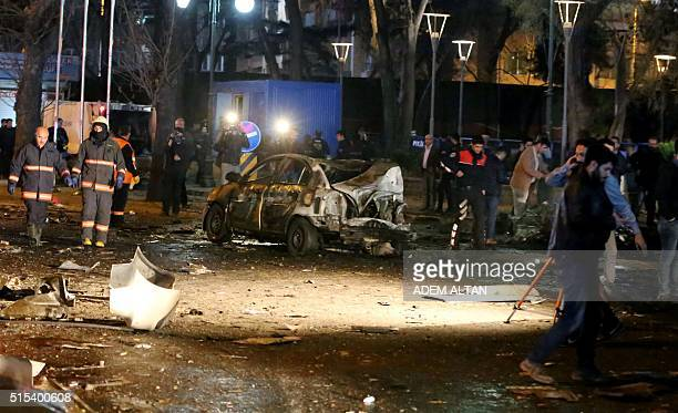 This picture taken on March 13 shows a burnt out car after a blast in Ankara An explosion ripped through a busy square in central Ankara on March 13...