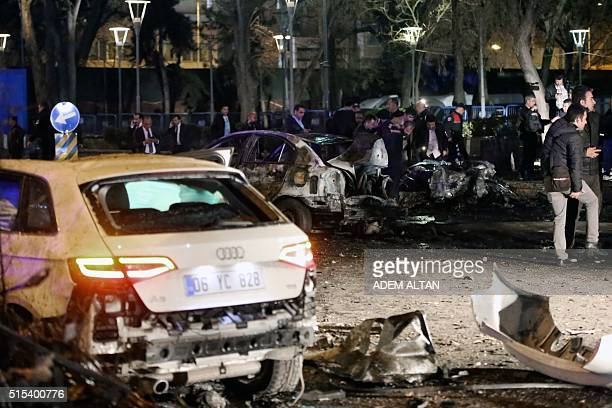 This picture taken on March 13 shows burnt out cars after a blast in Ankara An explosion ripped through a busy square in central Ankara on March 13...