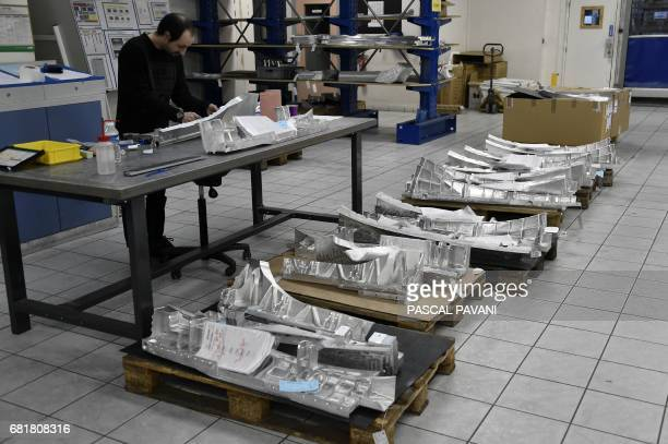 This picture taken on March 14, 2017 shows a Figeac-Aero subcontracting aeronautic employee for aircraft manufacturers Airbus, Boeing, Bombardier and...