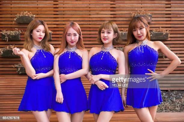 This picture taken on March 14 2017 shows Kpop group SixBomb members posing for a photo during an interview with AFP in Seoul All four members of...