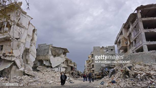 TOPSHOT This picture taken on March 14 shows destruction following an airstrike in the jihadistheld city of Idlib northwestern Syria Russian air...