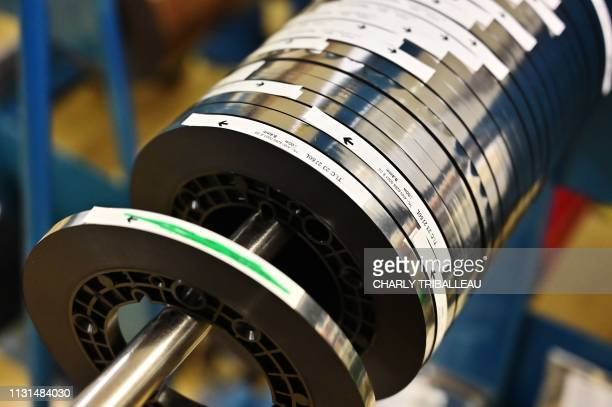 This picture taken on March 14 shows magnetic stripes used to make American Express bank cards in the production plant of Mulann in Avranches...
