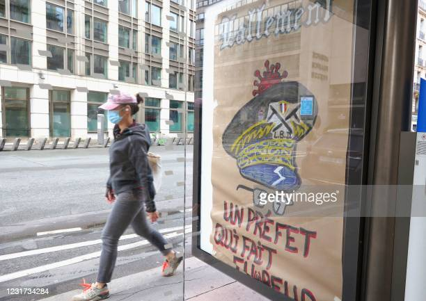 This picture taken on March 15 shows a poster pertaining to Paris police prefect Didier Lallement and with a play on words using the French...