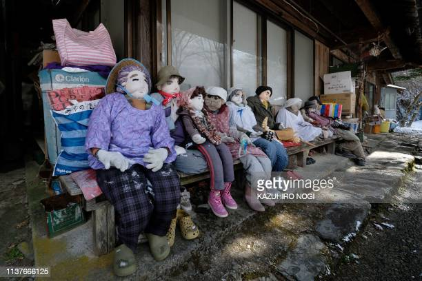 This picture taken on March 16 2019 shows lifesize dolls displayed in the tiny village of Nagoro in western Japan In the tiny village of Nagoro deep...
