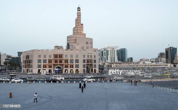 This picture taken on March 16, 2020 shows a view of the almost deserted Souq Waqif tourist bazaar in Qatar's capital Doha, with the spiral minaret...