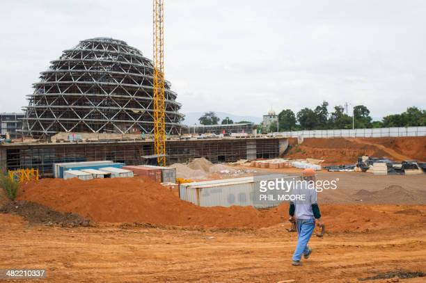 This picture taken on March 17 2014 shows a worker at the construction site of the Kigali Conference Centre currently being built in the Rwandan...