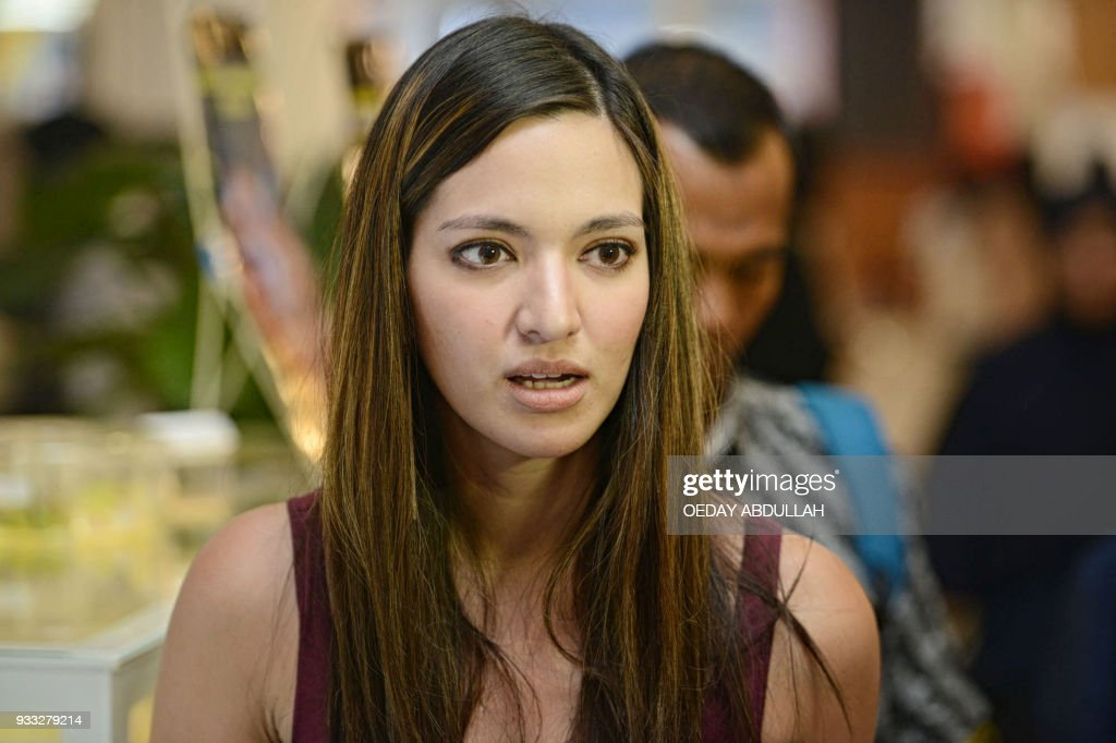 This Picture Taken On March   Shows Indonesian Actress Nia Ramadhani Posing During A