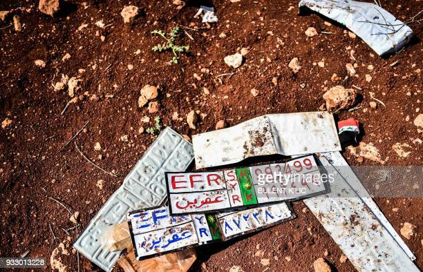 This picture taken on March 17 shows car plates near a check point in the village of Anab ahead of crossing to the Turkishbacked Syrian rebels side...