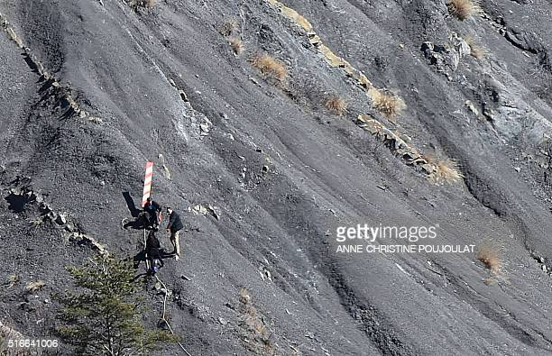 This picture taken on March 18 shows the beacon identifying the Germanwings aircrash impact site in the mountains near Le Vernet southern France An...
