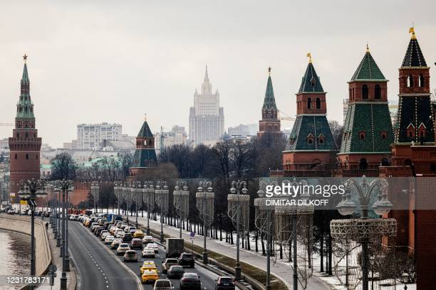 This picture taken on March 18 shows the Kremlin towers in front of the Russian Foreign Ministry headquarters. - Russian President Vladimir Putin on...