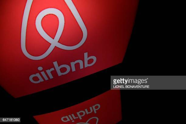 This picture taken on march 2 shows the logo of online lodging service Airbnb displayed on a computer screen in Paris