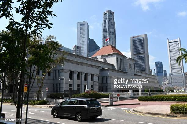 This picture taken on March 20 2019 shows the national flag flying on the roof of the Parliament House in Singapore Singapore proposed tough new...