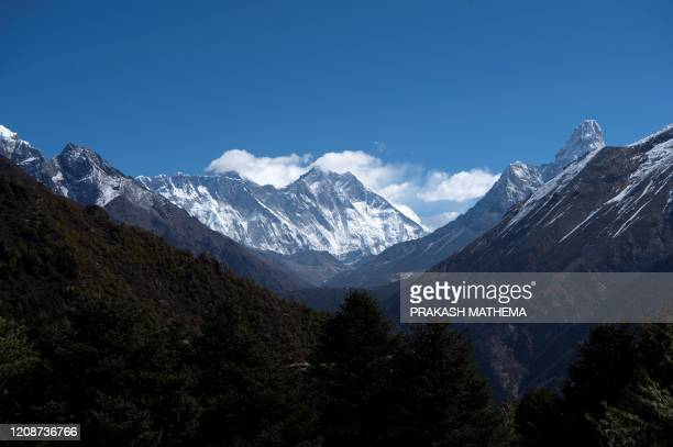 This picture taken on March 2020 shows Mount Everest and other peaks from Namche Bazaar, the last stop before base camp in the shadow of the world's...