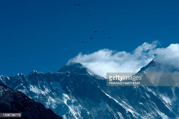 This picture taken on March 2020 shows Mount Everest from Namche Bazaar the last stop before base camp in the shadow of the world's tallest mountain...