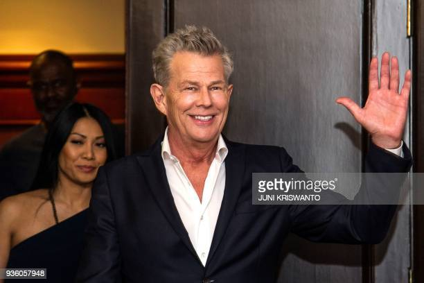 This picture taken on March 21 2018 shows Canadian composer and music producer David Foster arriving for a promotional event in Surabaya / AFP PHOTO...