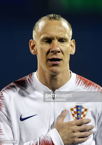 This picture taken on March 21 2019 shows Croatia's defender Domagoj Vida listening to the national anthem ahead of the Euro 2020 qualifying football...