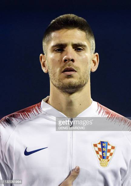 This picture taken on March 21 2019 shows Croatia's forward Andrej Kramaric listening to the national anthem ahead of the Euro 2020 qualifying...