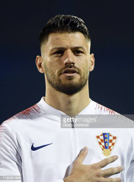 This picture taken on March 21 2019 shows Croatia's forward Bruno Petkovic listening to the national anthem ahead of the Euro 2020 qualifying...