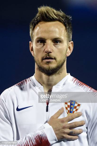 This picture taken on March 21 2019 shows Croatia's midfielder Ivan Rakitic listen to the national anthem ahead of the Euro 2020 qualifying football...